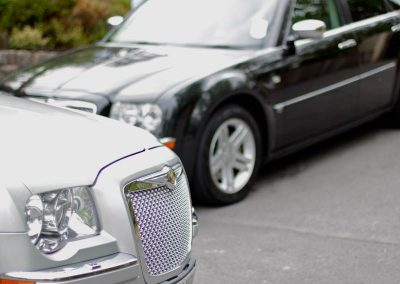 a closeup of a silver and ablack chauffeur driven luxury car in north somerset uk