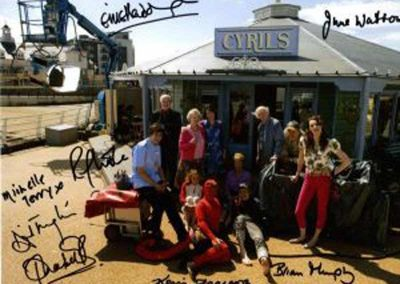 A signed photo of the cast of a TV show which was sent to their VIP chauffeur service