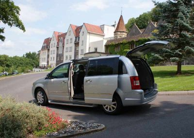A silver people carrier awaiting an exectutive passenger outseide a hotel in north somerset uk