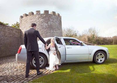 bride-and-groom-with-car