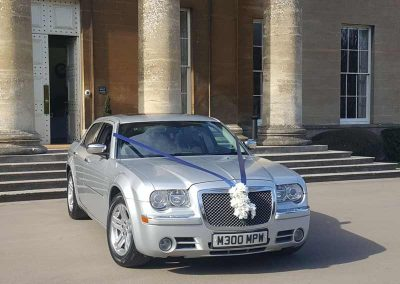 Luxury silver wedding car waiting for the bride outside a venue in somerset uk