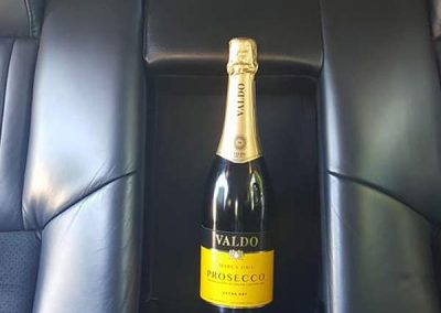 Interior of a wedding car with champagne to illustrate affordable luxury in north somerset uk