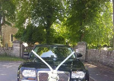 Black chauffeur driven wedding car to illustrate help to find your perfect wedding car