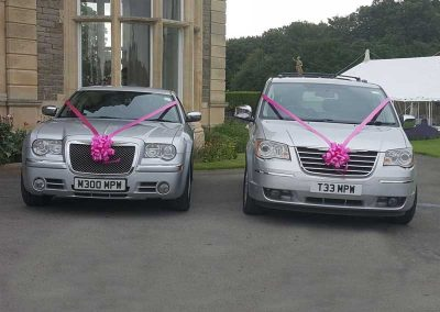 Two wedding cars with decorations outside a luxury hotel near Bath UK