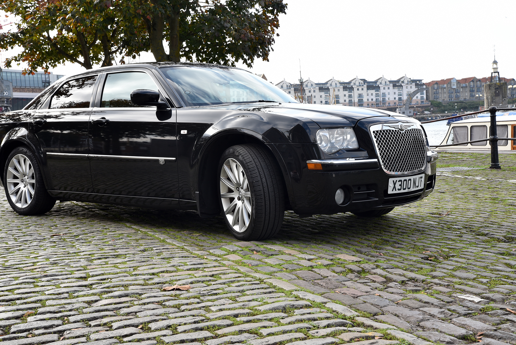 image of a wedding car reflected in the wingmirror of a luxury car to illustrate proffessional chauffeur services in south west UK